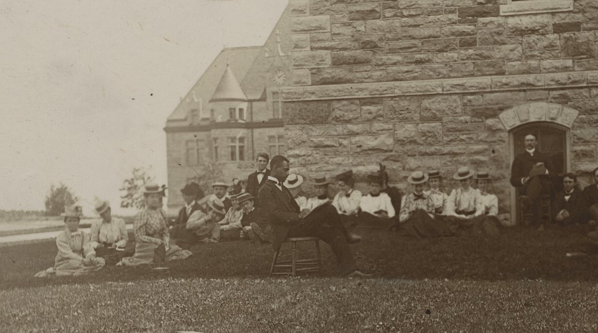 Studying on the lawn of Old Fraser, 1900.
